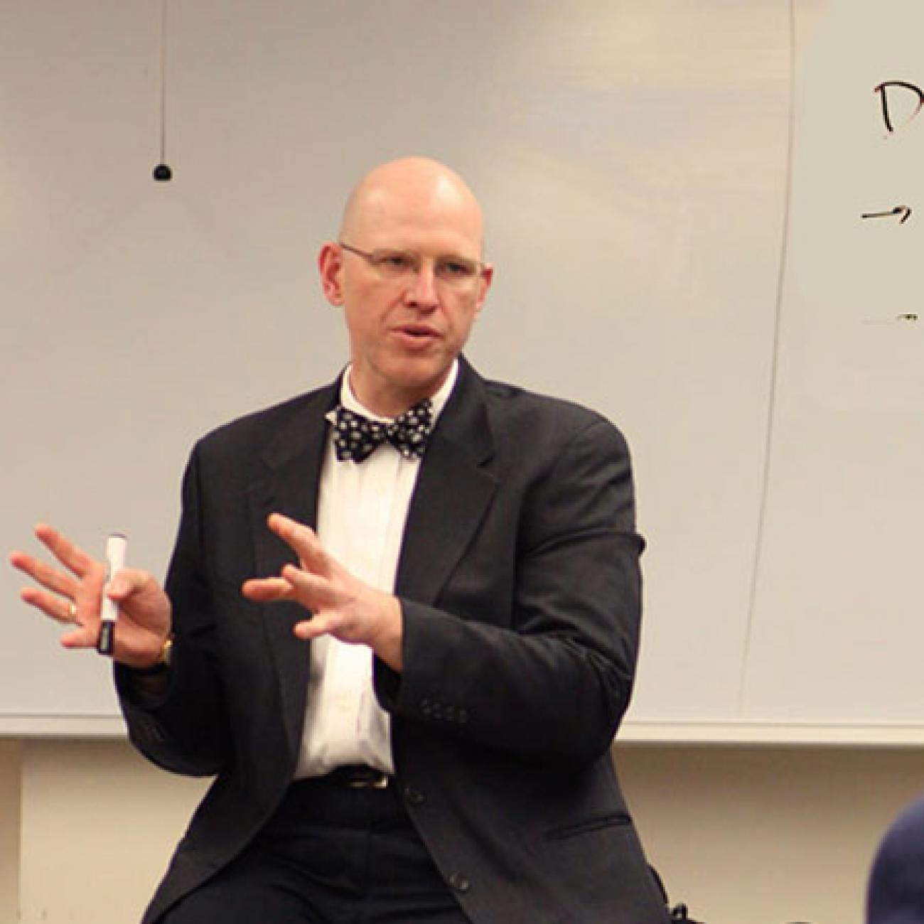 Connel Fullenkamp, professor of the practice of economics, teaches a classroom of undergraduates at Duke.