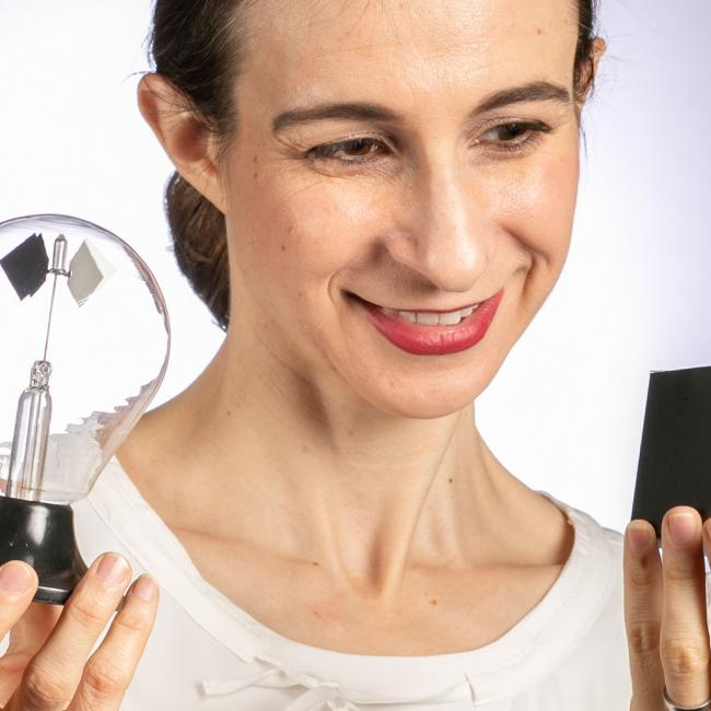 Cynthia Rudin holding a black box and light bulb